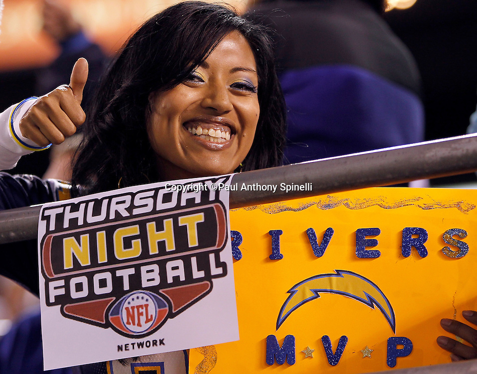 A San Diego Chargers fan gives a thumbs up during the NFL week 15 football game against the San Francisco 49ers on Thursday, December 16, 2010 in San Diego, California. The Chargers won the game 34-7. (©Paul Anthony Spinelli)