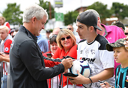 """Southampton manager Mark Hughes meeting fans during a pre season friendly match at Pride Park, Derby. PRESS ASSOCIATION Photo. Picture date: Saturday July 21, 2018. Photo credit should read: Anthony Devlin/PA Wire. EDITORIAL USE ONLY No use with unauthorised audio, video, data, fixture lists, club/league logos or """"live"""" services. Online in-match use limited to 75 images, no video emulation. No use in betting, games or single club/league/player publications."""