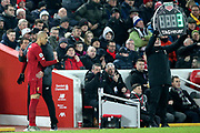 Liverpool midfielder Fabinho (3) gets his last minute instructions before coming on as a substitute  during the Premier League match between Liverpool and Manchester United at Anfield, Liverpool, England on 19 January 2020.