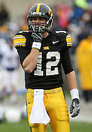 08 NOVEMBER 2008: Iowa quarterback Ricky Stanzi (12) tries to keep his hands warm during warmup before an NCAA college football game against Penn State, at Kinnick Stadium in Iowa City, Iowa on Saturday Nov. 8, 2008. Iowa beat Penn State 24-23.
