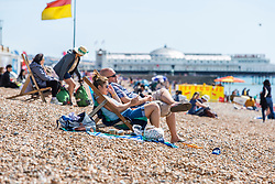 © Licensed to London News Pictures. 11/08/2016. Brighton, UK. Members of the public head out to the beach in Brighton and Hove as sunny and dry weather returns to the seaside resort. Photo credit: Hugo Michiels/LNP