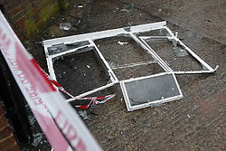 © Licensed to London News Pictures. 04/03/2018. Harold Hill, UK. The remains of a window lie in the back yard of Harold Hill Post Office where emergency services are currently responding to reports of an explosion. Nearby homes have been evacuated. Photo credit: Peter Macdiarmid/LNP