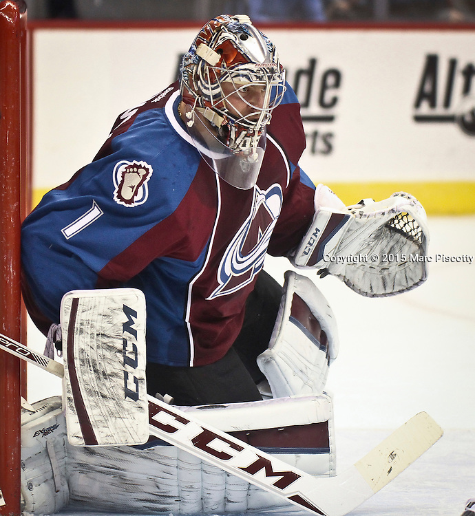 SHOT 1/10/15 1:37:11 PM - Colorado Avalanche goalie Semyon Varlamov #1 hugs the side of the net while keeping an eye on the puck against the Dallas Stars during their regular season game at the Pepsi Center in Denver, Co. Colorado won the game 4-3.  (Photo by Marc Piscotty / © 2015)