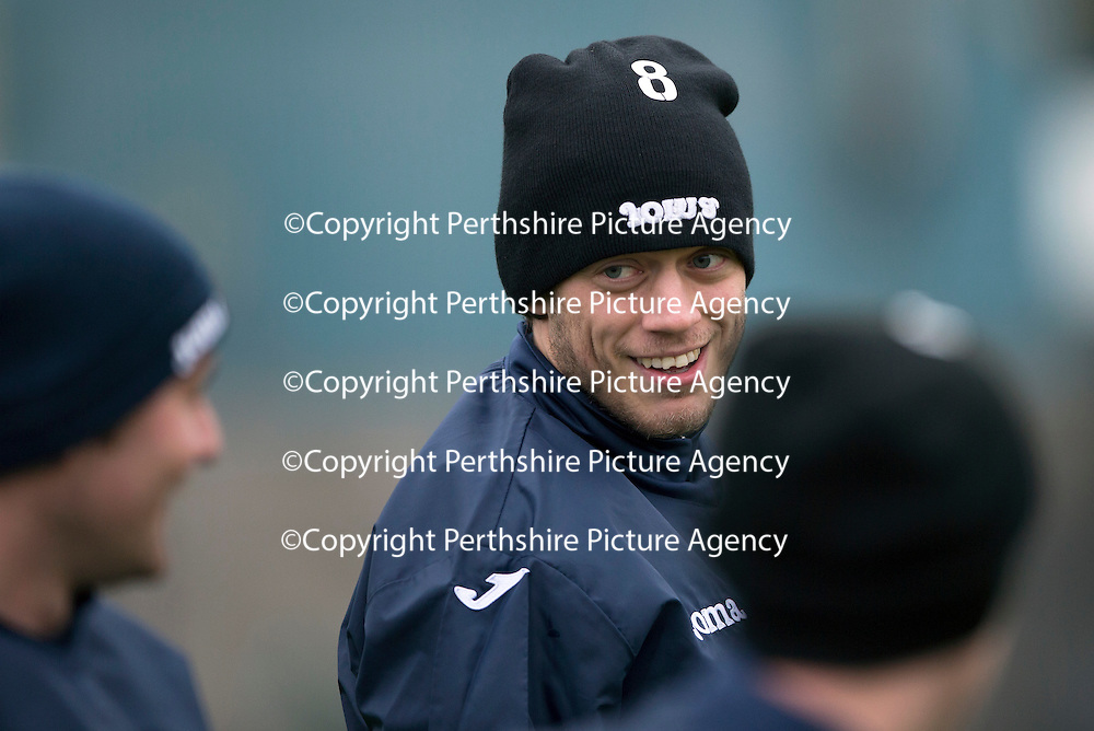 St Johnstone Training…18.12.15<br />Murray Davidson pictured habving a laugh in training this morning with Tam Scobbie at McDiarmid Park ahead of tomorrow's game against Hearts<br />Picture by Graeme Hart.<br />Copyright Perthshire Picture Agency<br />Tel: 01738 623350  Mobile: 07990 594431