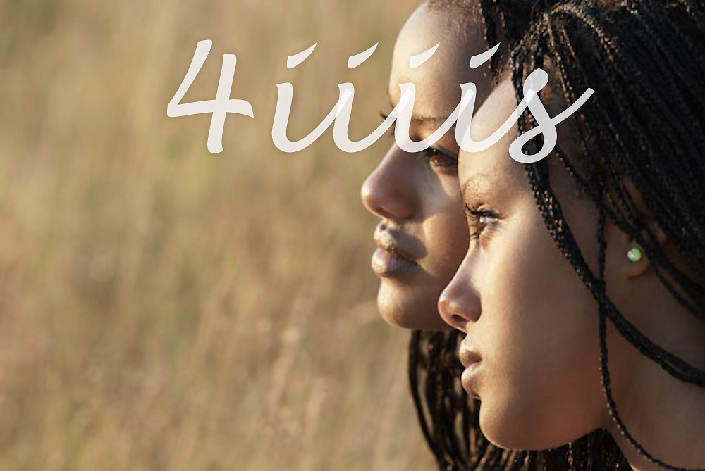 Twin sisters portrait in profile, braided hair, Manitoba prairie grasses in background.  High school seniors portrait.