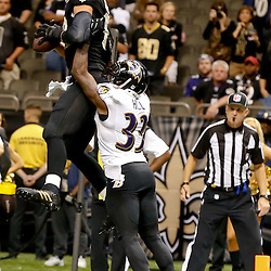Nov 24, 2014; New Orleans, LA, USA; New Orleans Saints tight end Jimmy Graham (80) catches a touchdown over Baltimore Ravens strong safety Will Hill (33) during the fourth quarter of a game at the Mercedes-Benz Superdome. The Ravens defeated the Saints 34-27. Mandatory Credit: Derick E. Hingle-USA TODAY Sports