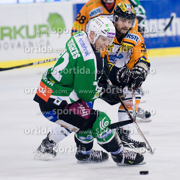 John Hughes (HDD Tilia Olimpija, #72) vs Stefan Herzog (Moser Medical Graz 99ers, #37) during ice-hockey match between HDD Tilia Olimpija and Moser Medical Graz 99ers in 21st Round of EBEL league, on November 21, 2010 at Hala Tivoli, Ljubljana, Slovenia. (Photo By Matic Klansek Velej / Sportida.com)