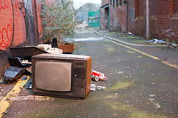 An old tv dumped in the street