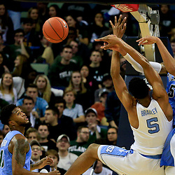 Nov 11, 2016; New Orleans, LA, USA; Tulane Green Wave guard Cameron Reynolds (5) blocks a shot attempt by North Carolina Tar Heels forward Tony Bradley (5) during the first half of a game at the Smoothie King Center. Mandatory Credit: Derick E. Hingle-USA TODAY Sports