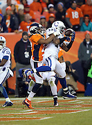 Indianapolis Colts wide receiver Hakeem Nicks (14) catches a 15 yard touchdown pass for a 21-10 third quarter lead while covered by Denver Broncos cornerback Bradley Roby (29) during the NFL week 19 AFC Divisional Playoff football game against the Denver Broncos on Sunday, Jan. 11, 2015 in Denver. The Colts won the game 24-13. ©Paul Anthony Spinelli
