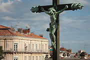 Local resident of top floor apartment looked down upon by crucified Christ on the cross in Montpellier, south of France.