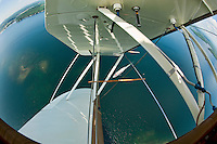 "A ""wingover"" combined with a ""spiral dive"" gave us quite the vantage point of the MS Mount Washington cruising on Lake Winnipesaukee from the open cockpit of Pilot Phil DiVirgilio's WACO WMF5C biplane.  (Karen Bobotas/for the Laconia Daily Sun)"