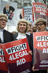 Hundreds of Lawyers,Solicitors and legal workers whilst bringing the legal system to a halt descend on Parliament to protest against legal aid cuts. London, United Kingdom. Friday, 7th March 2014. Picture by  i-Images / i-Images