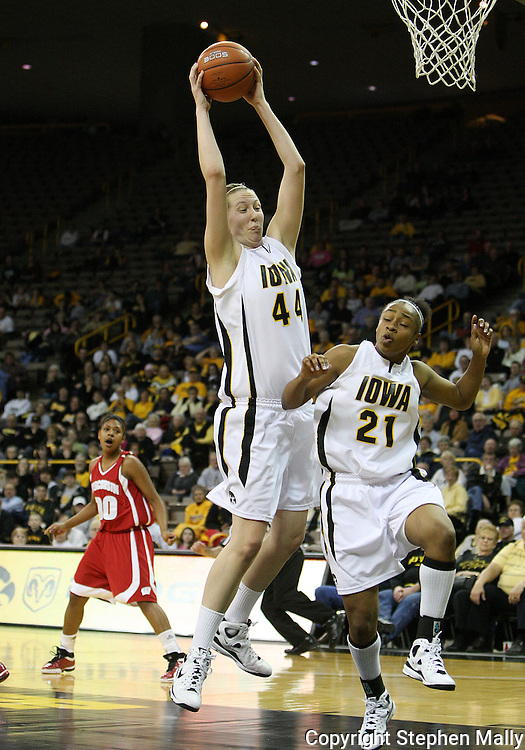 19 February 2009: Iowa center Megan Skouby (44) grabs a rebound in front of Iowa guard Kachine Alexander (21) during the second half of an NCAA women's college basketball game Thursday, February 19, 2009, at Carver-Hawkeye Arena in Iowa City, Iowa. Iowa defeated Wisconsin 72-65.
