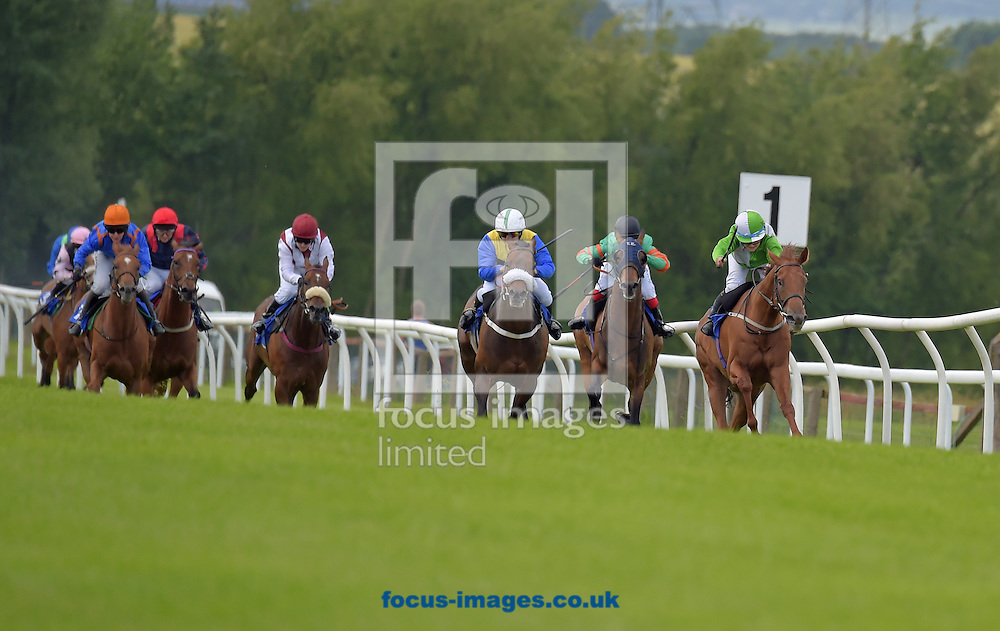 Belle Travers ridden by Emily Bullock (green and white quarters and green sleeves) wins Audrey Martin Memorial Ladies handicap stakes  at Pontefract Racecourse, Pontefract<br /> Picture by Martin Lynch/Focus Images Ltd 07501333150<br /> 27/06/2016