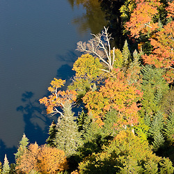 Lake Gloriette and foliage as seen from the cliffs above NH 26 in Dixville Notch, New Hampshire.