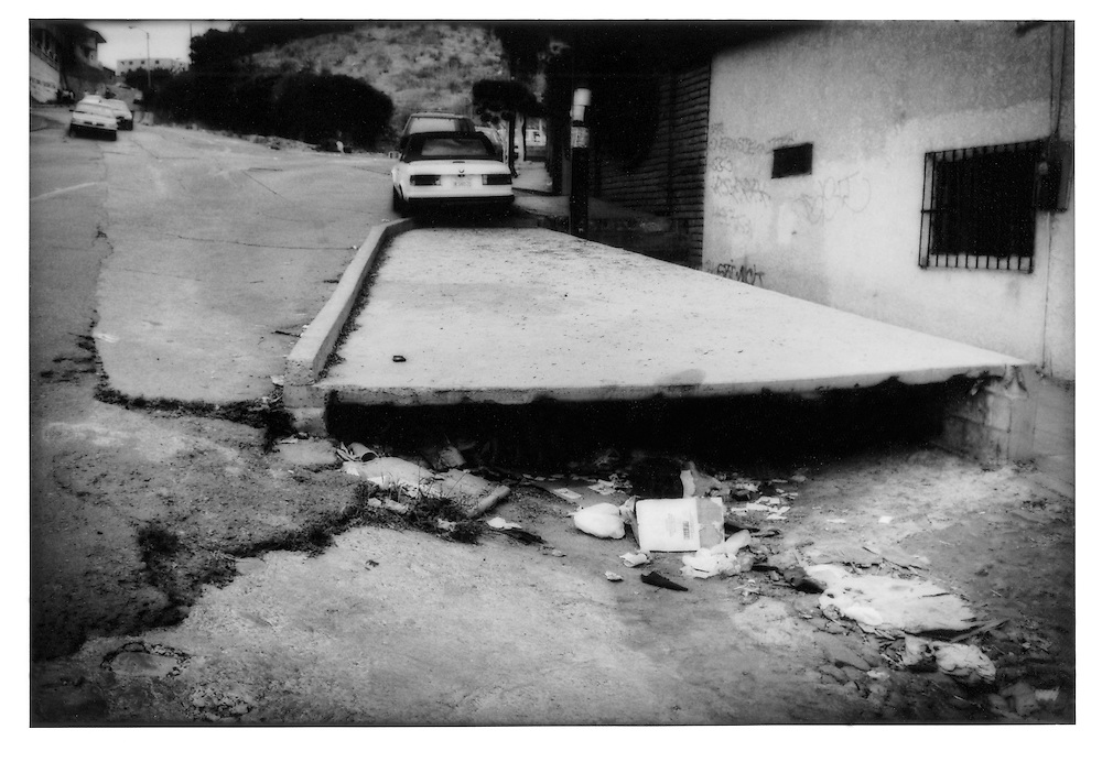 Trash blocks a dry storm drain in central Tijuana, Baja California, Mexico.  Tijuana does not possess as much water and more reflects the natural climate of the region.