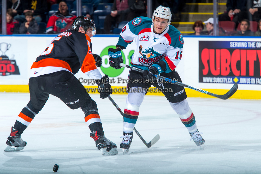 KELOWNA, CANADA - JANUARY 30: Kristians Rubins #5 of the Medicine Hat Tigers forechecks Carsen Twarynski #18 of the Kelowna Rockets on January 30, 2017 at Prospera Place in Kelowna, British Columbia, Canada.  (Photo by Marissa Baecker/Shoot the Breeze)  *** Local Caption ***