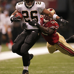 2008 September 28: New Orleans Saints running back Deuce McAllister (26) attempts to break the tackle of San Francisco 49ers linebacker Patrick Willis (52) during the NFL week four game between the San Francisco 49ers and the New Orleans Saints at the Louisiana Superdome in New Orleans, LA.