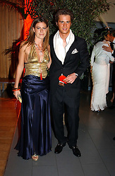MISS FRANCESCA VERSACE and PHILIP SCHULER at Andy & Patti Wong's Chinese New Year party to celebrate the year of the Rooster held at the Great Eastern Hotel, Liverpool Street, London on 29th January 2005.  Guests were invited to dress in 1920's Shanghai fashion.<br /><br />NON EXCLUSIVE - WORLD RIGHTS