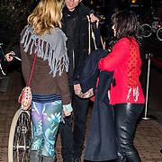 NLD/Amsterdam/20161222 - Première 32ste Wereldkerstcircus, Ellen ten Damme  word afgezet op de fiets door haar partner