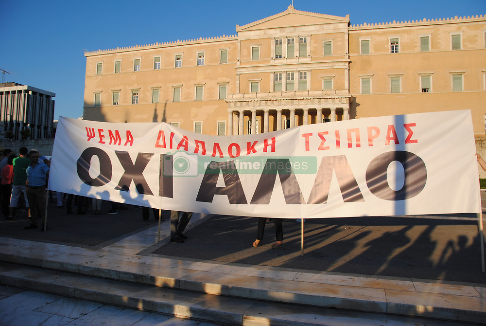 June 20, 2017 - Athens, Attiki, Greece - Demonstrators hold a banner that reads '' No more'' in front of the Greek Parliament..Demonstration in Syntagma square of the 'Resign' movement a movement that begun through facebook and called for the resign of the Greek goverment and a stop in austerity. (Credit Image: © George Panagakis/Pacific Press via ZUMA Wire)