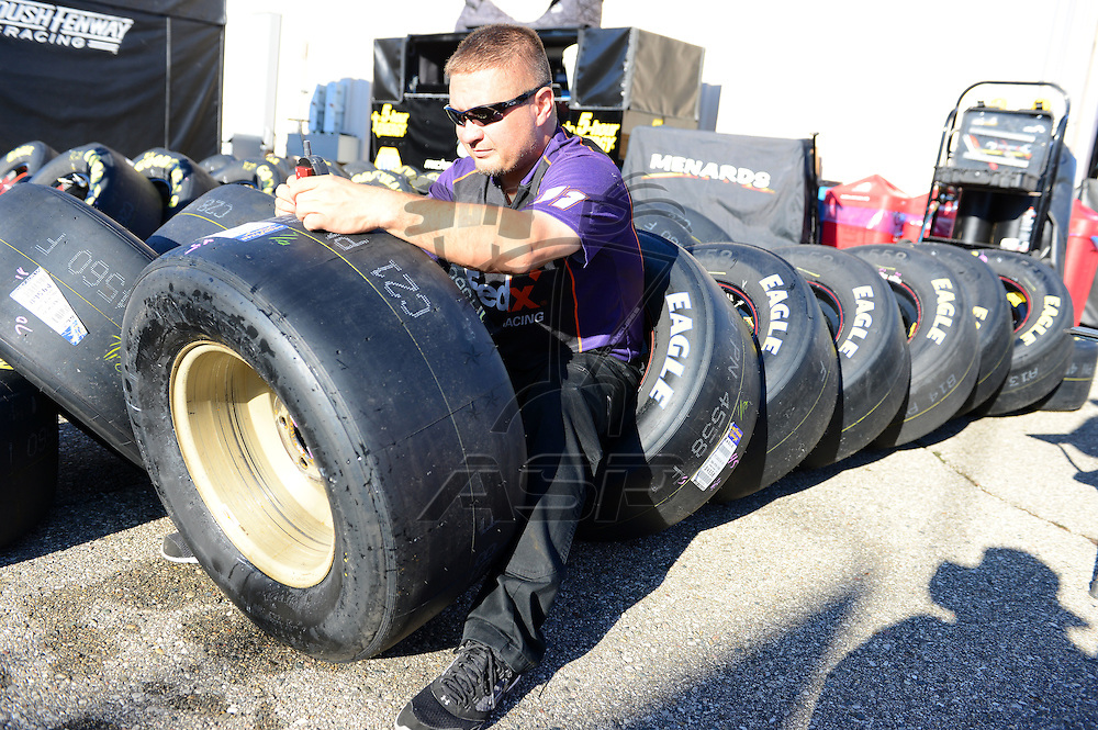 Brooklyn, MI  - Aug 17, 2012:  Crew members of Denny Hamlin works on tires during practice for the Pure Michigan 400 at Michigan International Speedway in Brooklyn, MI.