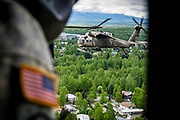 Black Hawk helicopters from the Alaska US National Guard en route to Homer, escorting the King Harald of Norway.