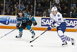 January 11, 2011; San Jose, CA, USA; Toronto Maple Leafs center Mikhail Grabovski (84) skates past San Jose Sharks defenseman Marc-Edouard Vlasic (44) during the first period at HP Pavilion. Mandatory Credit: Jason O. Watson / US PRESSWIRE