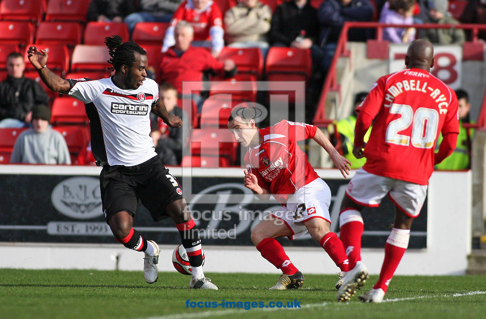 Barnsley - Saturday 21st February 2009 : Michael Mifsud of Barnsley & Kelly Youga of Charlton Athletic in action during the Coca Cola Championship match at Oakwell, Barnsley. (Pic by Steven Price/Focus Images)