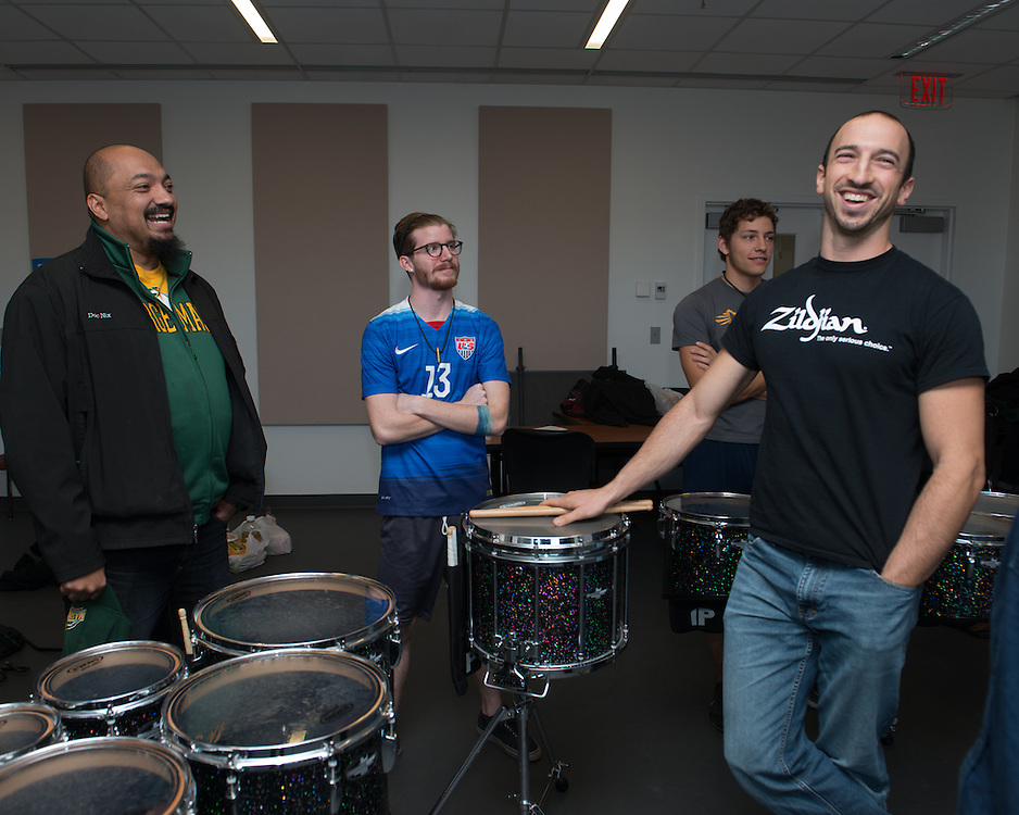 December 5, 2015 - Fairfax, VA - A day in the life of &quot;Doc Nix,&quot; aka Dr. Michael Nickens, the Director of the Athletic Bands for George Mason University. Here Doc Nix meets with the percussion unit and assistant Chris Gary (?).<br /> <br /> Photo by Susana Raab