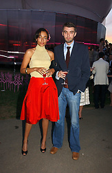Writer ZADIE SMITH and poet NICK LAIRD at the Serpentine Gallery Summer party sponsored by Yves Saint Laurent held at the Serpentine Gallery, Kensington Gardens, London W2 on 11th July 2006.<br />