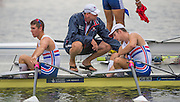 Hamburg. GERMANY.   GBR JM2X. Fraser RUSSELL and James WHITE are greeted by their Coach: Dez ATKINS after Saturday Morning, Semi Finals C/D  at the 2014 FISA Junior World rowing. Championships.  09:36:23  Saturday  09/08/2014  [Mandatory Credit; Peter Spurrier/Intersport-images] 2014. Empacher. Hamburg.
