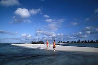 French Polynesia, Islands in the South Pacific, part of the French overseas Territories.Photo by Owen Franken.On the island of Raniroa...Photo by Owen FrankenFrench Polynesia, Islands in the South Pacific, part of the French overseas Territories..couple on a beach on Rangiroa..Photo by Owen Franken