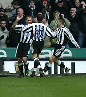 Photo. Andrew Unwin.<br /> Newcastle United v Charlton Athletic, FA Barclaycard Premier League, St James Park, Newcastle upon Tyne 20/03/2004.<br /> Newcastle's goalscorer, Alan Shearer (l) celebrates with team-mates Laurent Robert (c) and Darren Ambrose (r).