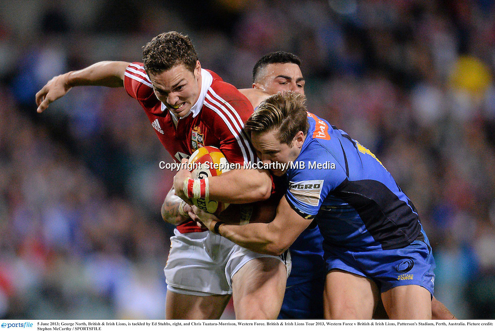 5 June 2013; George North, British & Irish Lions, is tackled by Ed Stubbs, right, and Chris Tuatara-Morrison, Western Force. British & Irish Lions Tour 2013, Western Force v British & Irish Lions, Patterson's Stadium, Perth, Australia. Picture credit: Stephen McCarthy / SPORTSFILE