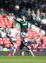 Hibernian's Scott Robinson over Falkirk's Tom Taiwo.<br /> half time : Hibernian 0 v 0  Falkirk, William Hill Scottish Cup semi-final, played 18/4/2015 at Hamden Park, Glasgow.