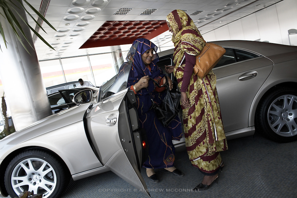 Afaf Osman, 59 and Asha Abdurhim, 47, taking a look at a new Mercedes in the DAL Motor Co showroom, Khartoum, Sudan, on Thursday, Apr. 12, 2007. The sales of luxury cars is increasing in Khartoum..Khartoum is modeling itself as the Dubai of Africa and despite Western sanctions the city is booming. Away from the troubles and poverty that plaque the rest of Sudan, development in Khartoum is moving at an astonishing rate. Investment from the East, and in particular China, allowed the Sudanese economy to grow by 11% in 2007. This growth is driven largely by oil, with production rising from 63,000 barrels per day in 1999 to over 500,000 barrels today.