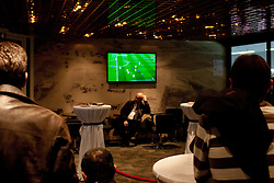 People watching a football classics Barcelona vs Real Madrird during ice-hockey match between Austria and Slovenia at IIHF World Championship DIV. I Group A Slovenia 2012, on April 21, 2012 at SRC Stozice, Ljubljana, Slovenia. (Photo By Matic Klansek Velej / Sportida.com)