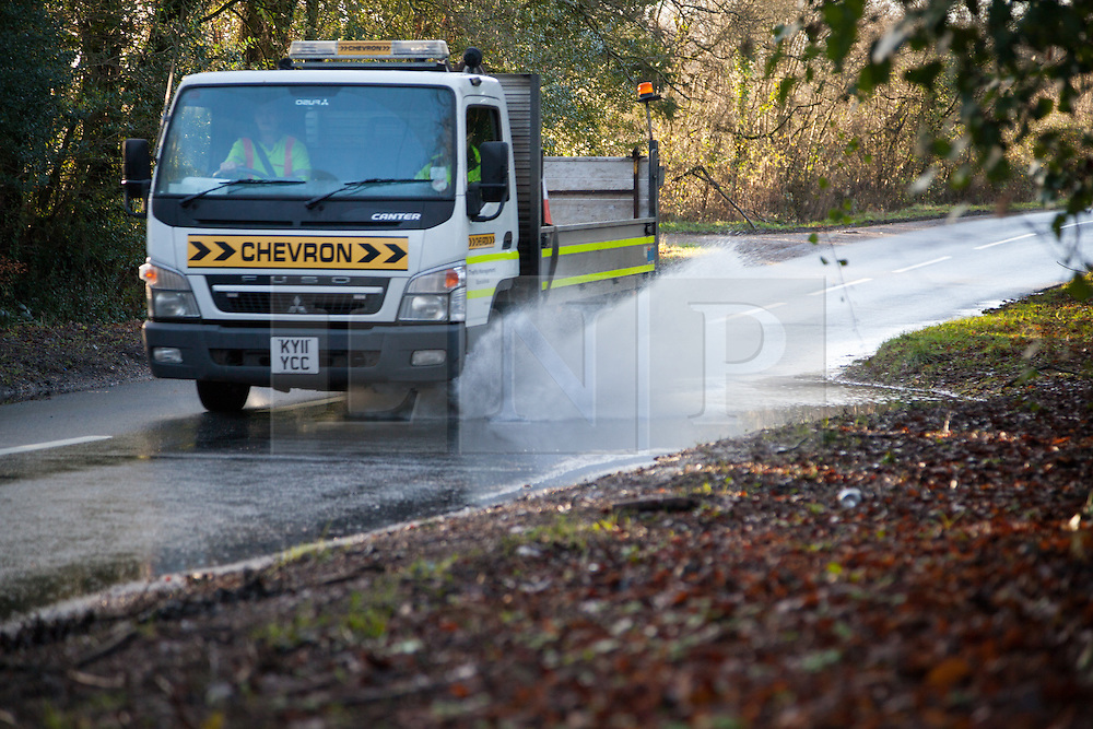 © Licensed to London News Pictures. 02/01/2014. River Blackwater, Hampshire, UK. A lorry passing through standing water on a road near to Wellow Mill near Romsey in Hampshire, UK. River levels are high following a night of wet and windy weather. More wet and windy weather is forecast. Photo credit : Rob Arnold/LNP