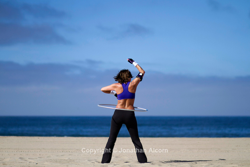 A hula hooper on Venice Beach on Monday morning.