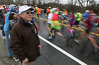 04/20/2015 -  Tufts University Marathon Team coach Don Megerle looks out for his runners as they approach the Tufts University cheering section at Mile 9 of the 2015 Boston Marathon in Natick, Massachusetts  April 20, 2015. (Matthew Healey for Tufts University)