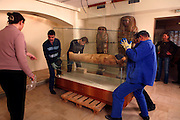 "GEORGES LABIT MUSEUM, TOULOUSE, FRANCE - MARCH 03 - EXCLUSIVE : A general view of the Egyptian mummy encased in a sarcophagus moved by warehousemen that are about to take the cover off under the control of the Conservationist on March 3, 2009 in the Georges Labit Museum, Toulouse, France. The Egyptian mummy arrived in Toulouse in 1849, encased in a sarcophagus labelled ""In-Imen"" from the 7th or 8th century BC. It is preserved at the Labit Museum since 1949. The mummy has been the subject of a very rare tissue sampling operation to determine its datation.  (Photo by Manuel Cohen)"