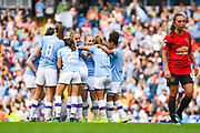 Manchester City Women forward Caroline Weir (19) scores a goal and celebrates to make the score 1-0 during the FA Women's Super League match between Manchester City Women and Manchester United Women at the Sport City Academy Stadium, Manchester, United Kingdom on 7 September 2019.