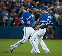 21 October 2015: Toronto Blue Jays pitcher Roberto Osuna (54) and right fielder Jose Bautista (19) react at the end of game 5 of ALCS against Kansas City Royals at Rogers Centre Toronto ON Canada. Jays beat Royals  7 - 1. (Photo by Peter Llewellyn/Icon Sportswire)