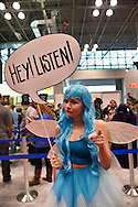 "Manhattan, New York City, New York, USA. October 10, 2015. EMILY from Long Island is a cosplayer portraying Navi from Zelda, and holds a speech bubble saying ""HEY LISTEN!"" at the 10th Annual New York Comic Con. NYCC 2015 is expected to be the biggest one ever, with over 160,000 attending during the 4 day ReedPOP event, from October 8 through Oct 11, at Javits Center in Manhattan"