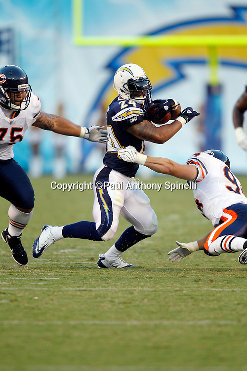 San Diego Chargers rookie running back Ryan Matthews (24) dodges a tackle attempt by Chicago Bears rookie linebacker Matt Mayberry (94) and Bears defensive tackle Matt Toeaina (75) as he runs the ball after catching a pass during a NFL week 1 preseason football game against the Chicago Bears, Saturday, August 14, 2010 in San Diego, California. The Chargers won the game 25-10. (©Paul Anthony Spinelli)