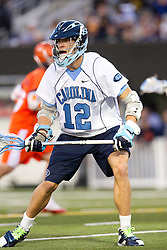 10 April 2010: North Carolina Tar Heels midfielder Logan Corey (12) during a 7-5 loss to the Virginia Cavaliers at the New Meadowlands Stadium in the Meadowlands, NJ.