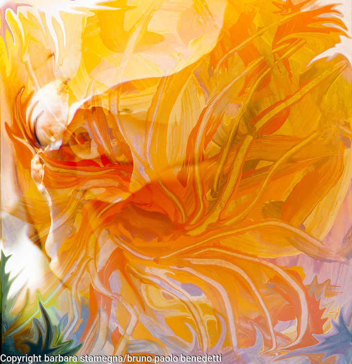 orange dreamy flower like abstract art image in dominant orange color and yellow shades with fluid abstract shapes