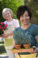 Two women gardening, focus woman in foreground